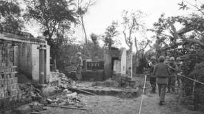 American soldiers look over the remains of a