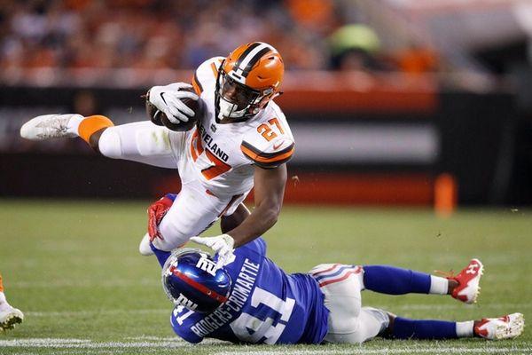 Giants cornerback Dominique Rodgers-Cromartietackles Browns running back Matthew