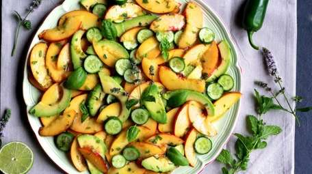 Thinly sliced peaches and avocado are dressed with