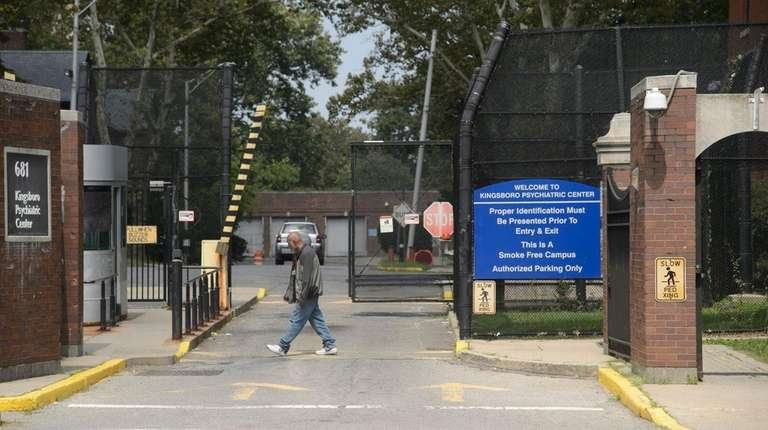 A person walks past an entrance to Kingsboro