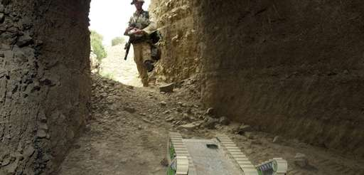U.S. soldier maneuvers robot into cave to detect