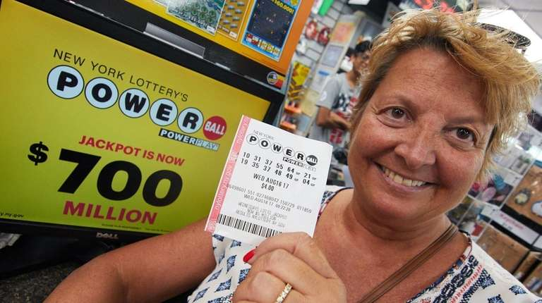Terry Patrani, of Nesconset, holds the Powerball ticket