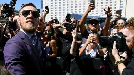 UFC lightweight champion Conor McGregor arrives at Toshiba