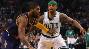 Kyrie Irving of the Cavaliers drives against Isaiah