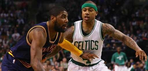 Kyrie Irving of the Cavaliers, left, drives against
