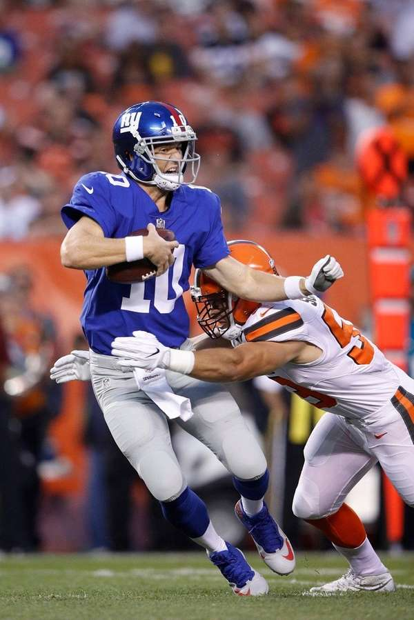 Eli Manning of the Giants gets sacked
