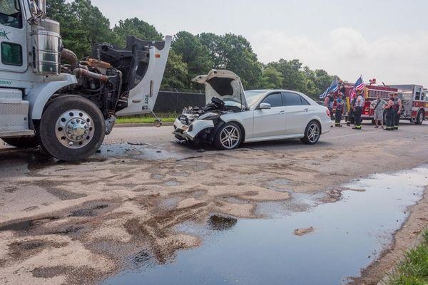 A Mercedes-Benz driver struck a tractor trailer on