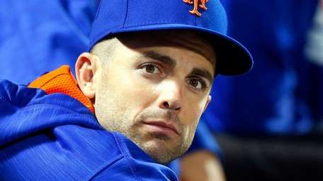 David Wright of theMets looks on against the