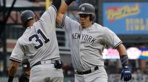 The Yankees' Gary Sanchez, right, is congratulated by