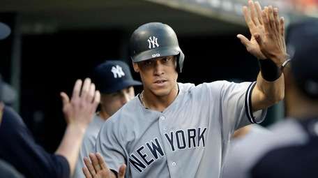 The Yankees' Aaron Judge is greeted in the