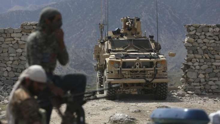 U.S. forces and Afghan security police in Asad