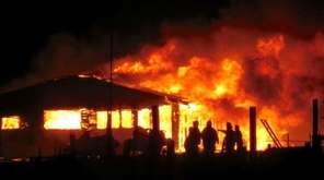 Firefighters respond to a blaze on Oak Island