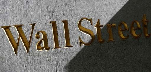 A Wall Street sign on the side of
