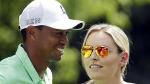 Lindsey Vonn speaks to Tiger Woods during the