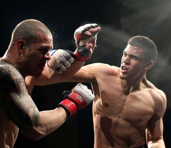 Andrews Rodriguez, right,defeated Chris Acevedo at 170 pounds