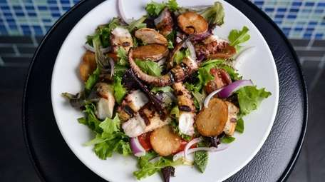 Grilled octopus salad, with  tomato, onion, and potato