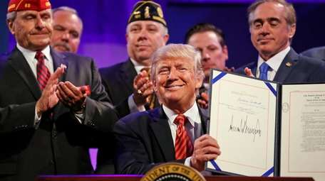 President Donald Trump signed into law a bill