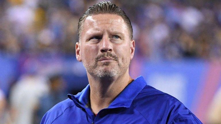 Giants head coach Ben McAdoo walks off the