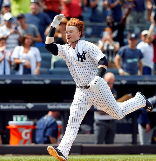 Clint Frazierof the Yankees celebrates his ninth-inning walk-off
