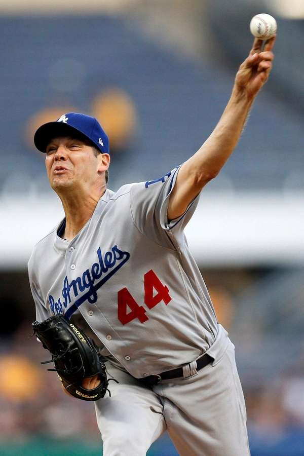 Dodgers starter Rich Hill pitches against the Pirates