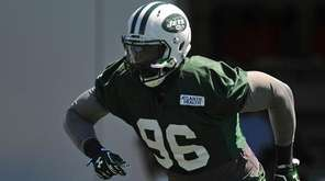 Muhammad Wilkerson of the Jets works on fumble recovery drills