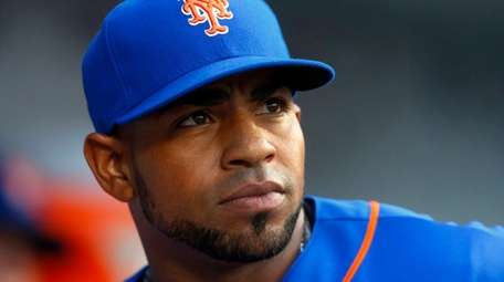 Yoenis Cespedesof theMets looks on before a game