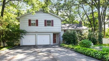 This Greenlawn split-level, listed for $587,000, includes a