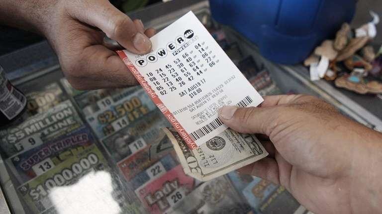 Doreen Nelson, of Lindenhurst, with the Powerball ticket