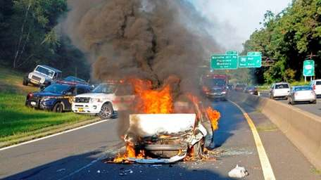 Firefighters respond to a vehicle fire that closed
