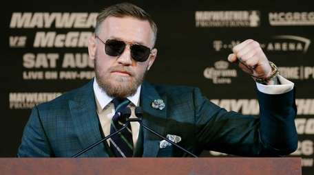 Conor McGregor speaks during a news conference Wednesday,