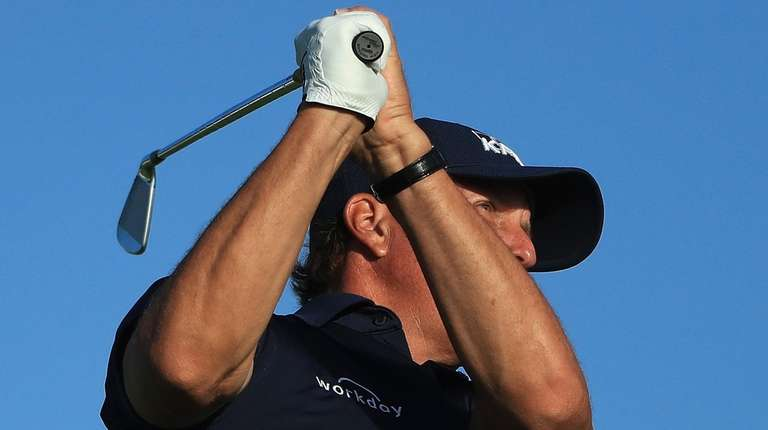 Phil Mickelson plays his shot from the 11th