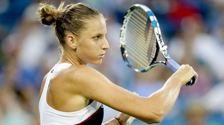 Karolina Pliskova returns a shot to Natalia Vikhlyantsevao