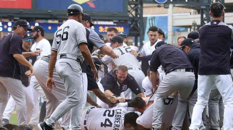 Tigers'Miguel Cabrera lays on the ground during a