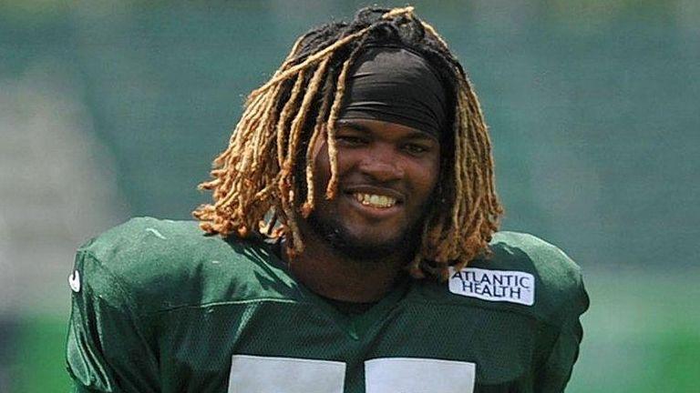 Lorenzo Mauldin of the New York Jets stretches