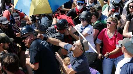 White nationalist demonstrators clash with counterdemonstrators at the