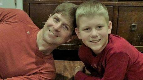 Kidsday reporter Griffin Strauss with his dad, Derek