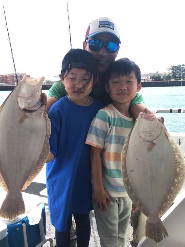 Young anglers show off a brace of keeper