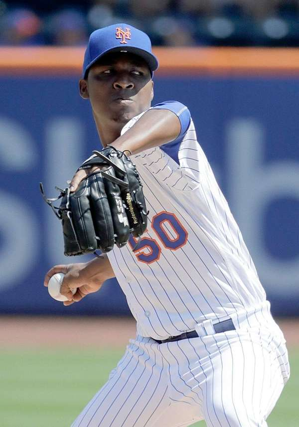 Mets starting pitcher Rafael Montero delivers during the