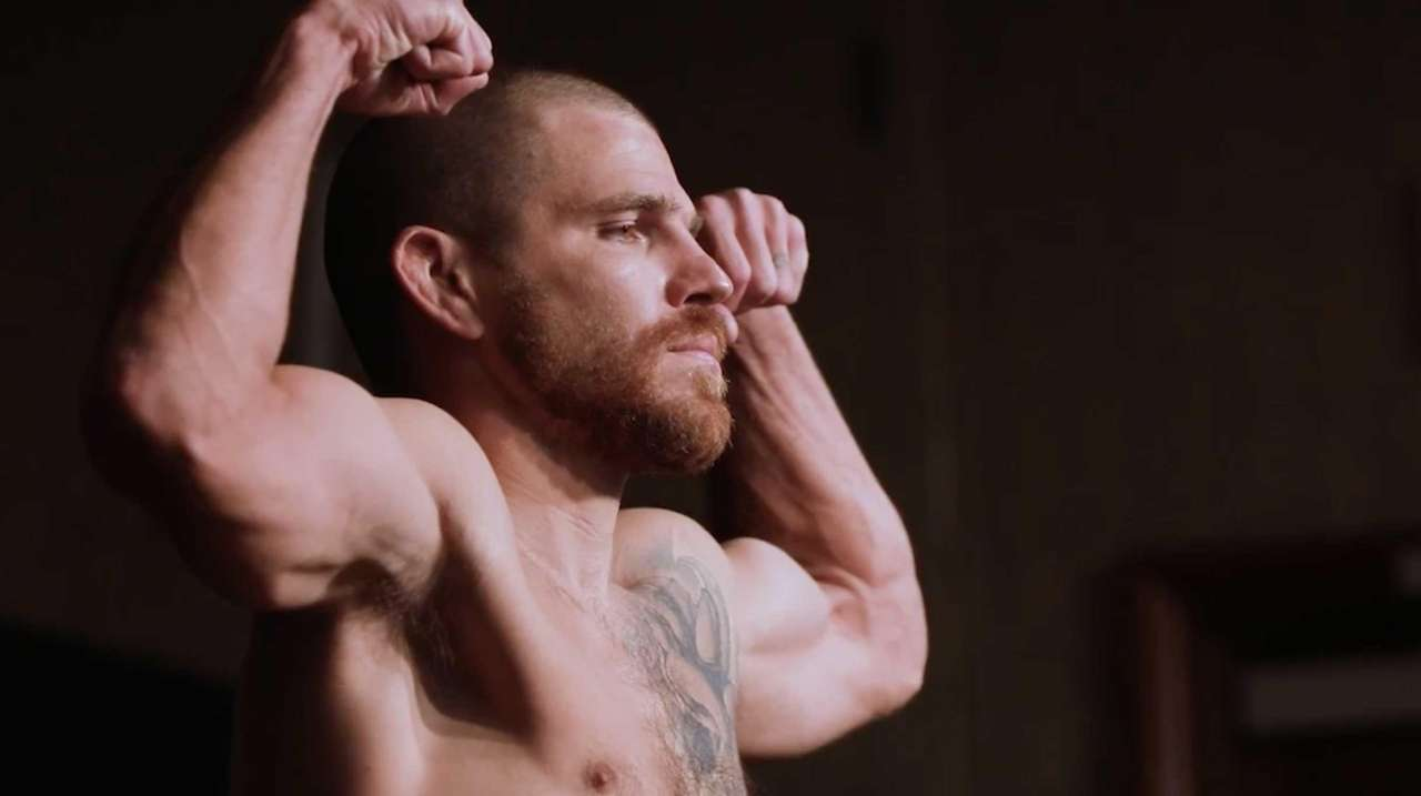 UFC fighter Jim Miller weighs-in for a bout.