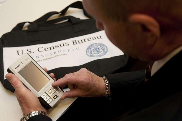 A census worker in Garden City examines new