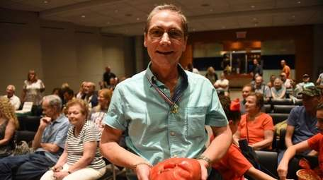 Alberto Oppedisano stands with his winning tomato at