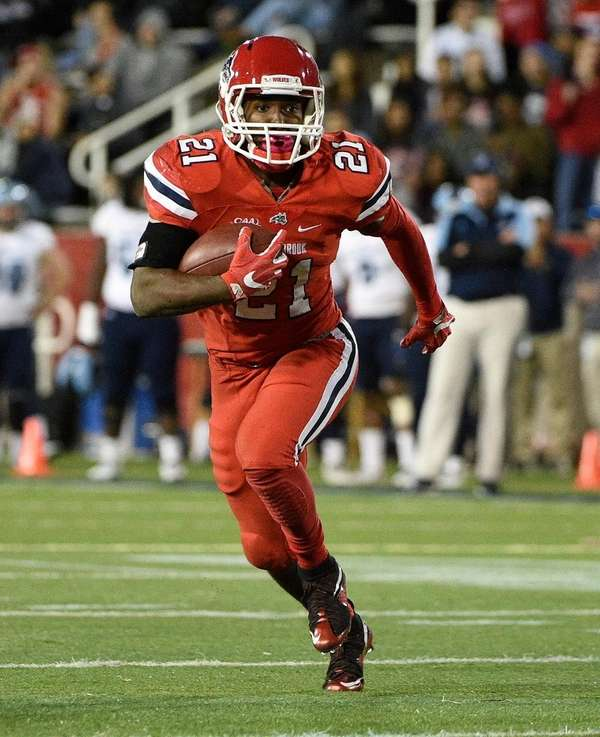Stony Brook running back Stacey Bedell runs for