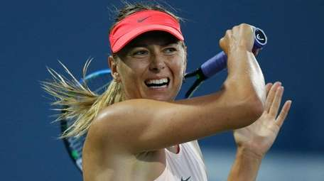 Maria Sharapova competes against Jennifer Brady of the
