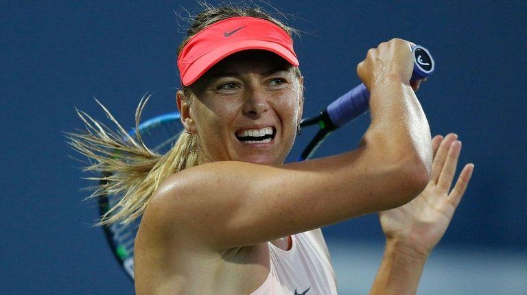 Maria Sharapova competes against Jennifer Brady of the