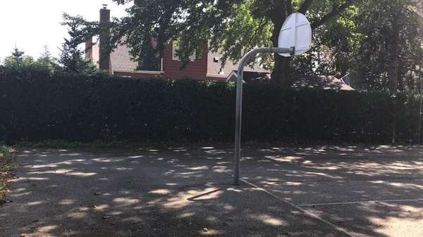 Rims have been removed from the basketball court