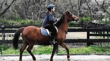 Kidsday reporter Vincenza Julian practices her riding skills