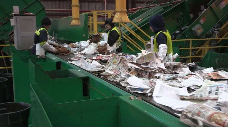 Employees sort paper at the Green Stream recycling