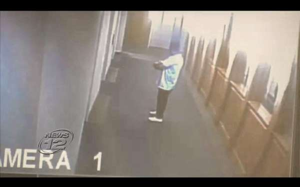 Surveillance video shows suspect allegedly walking off with