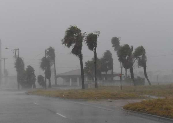 Strong winds batter a house on Padre Island