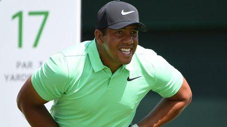 Jhonattan Vegas watches his tee shot from the